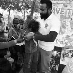 distribution of old clothes to needy