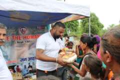 save the humanity row food for distribution in slum area